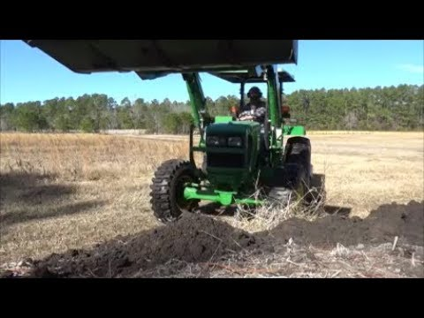 how to operate a John Deere tractor part 3: mowing and scooping