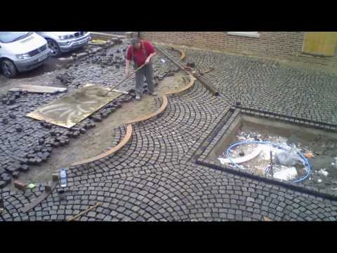 laying reclaimed granite setts for driveway and courtyard to French style