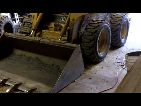How to change skid loader tire with no jack