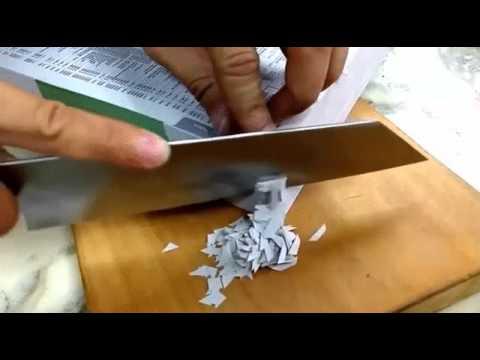 Sharp Knife Cutting Into Phonebook