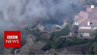 Wildfire: Aerial shots show devastation - BBC News