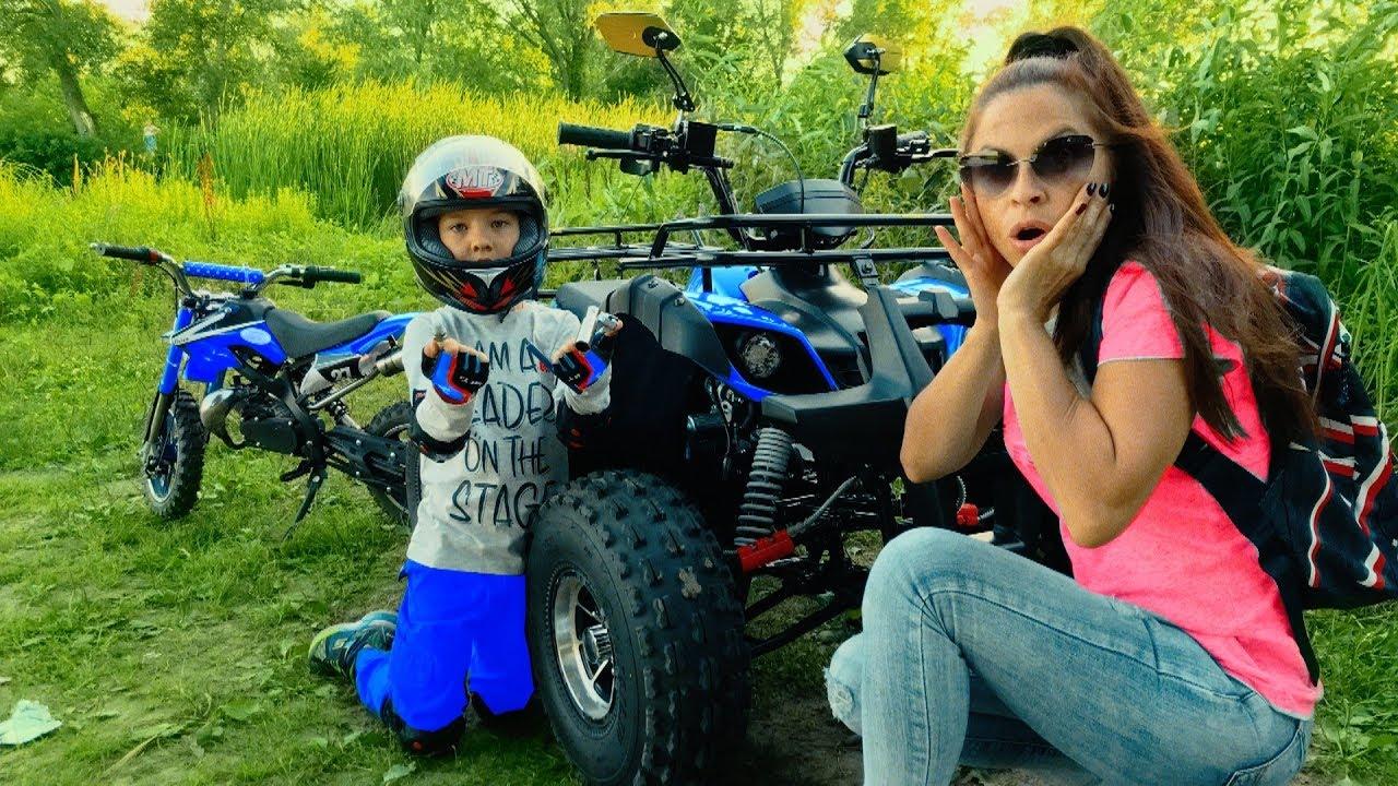 Den help Mom fix broken Quad bike