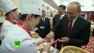 Bon Appetit! Putin cooks Chinese food