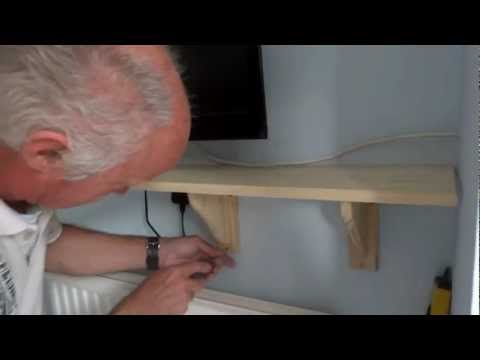 How to fix a wooden shelf to a solid wall