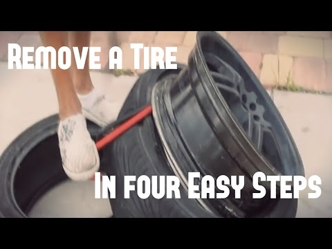 How to remove a tire from a rim