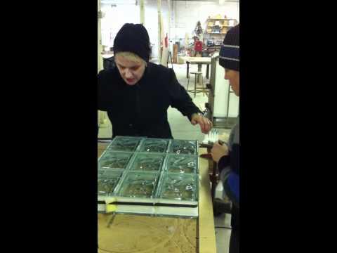 Jill bands a glass block window