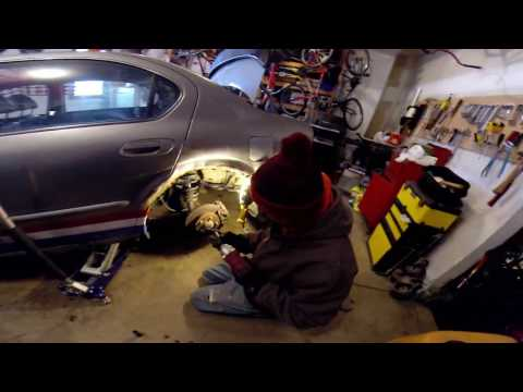 How to replace the rear strut mount on 1995-2003 Nissan Maxima