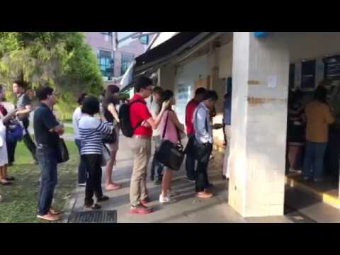 People queueing up to deposit money at a POSB outlet at Tampines Central