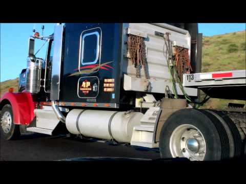Kenworth Truck Pulling a Flatbed Trailer