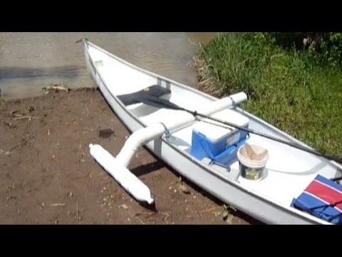 The worlds Coolest $100 Catfishing Canoe with homemade outrigger Canoe stabilizer