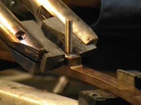 Soldering a threaded rod to a thick copper ring to immobilize the rod.