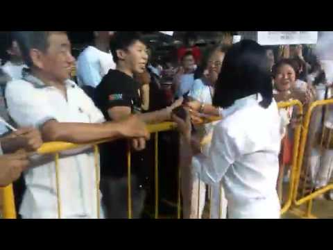 PAP's Cheryl Chan greeting supporters as they chant her name