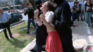 Women forcefully milked in the street (269life animal rights performance)