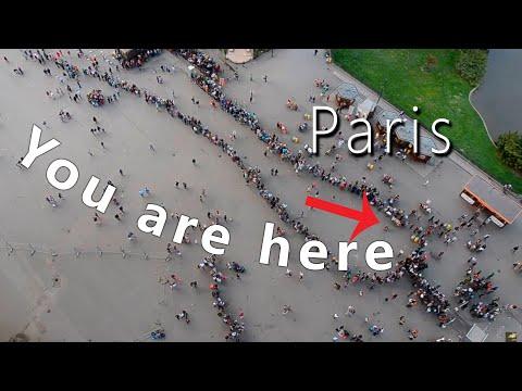 Eiffel tower Paris - Entrance line. People form of condom :)