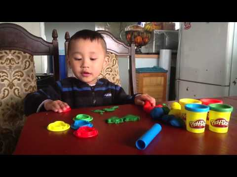 Troy with Superhero Play-Dohs