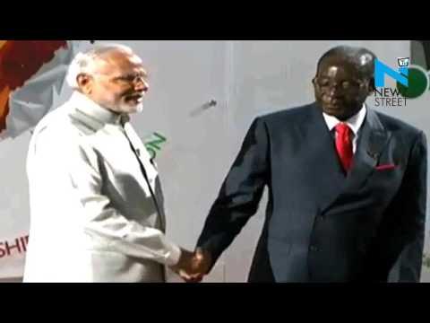 PM Modi assists Mugabe to ascend the dais