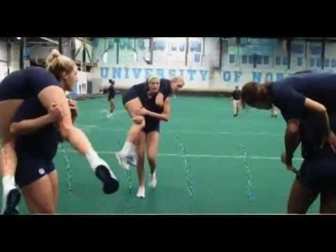 tall women fireman carry and sprint using each other