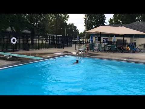 Kindergartener swimming in deep water