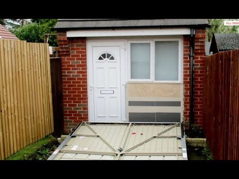 Couple fined for using garage door to hide secret home from council