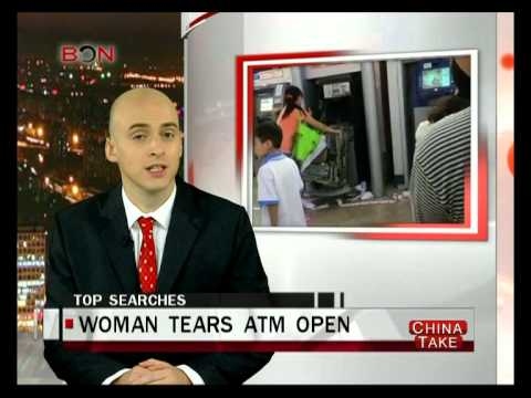 Woman tears ATM open with bare hands - China Take - Oct 23 ,2014 - BONTV China