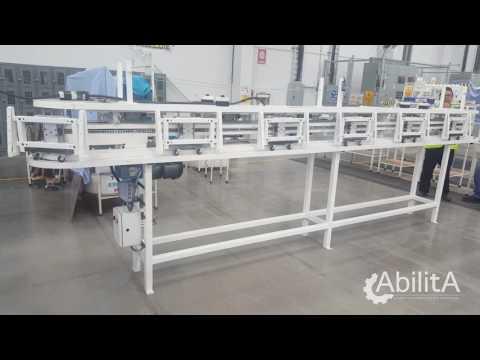 Sistema transportador para ensamble de arnes