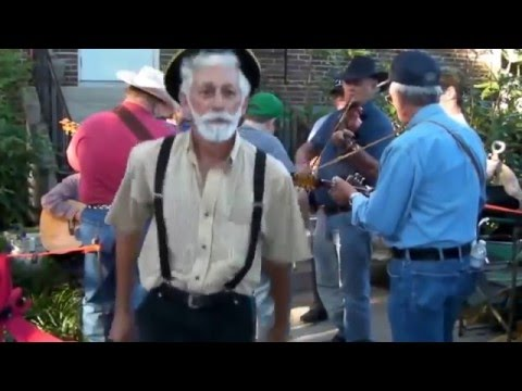 Old man on drugs is dancing to hardcore