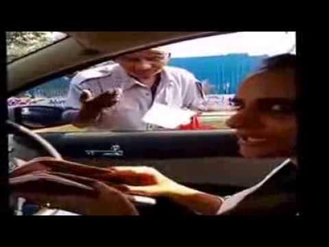 Beggar asks money with credit card machine