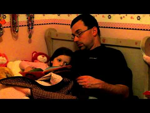 Daddy falling asleep while reading to our little girl