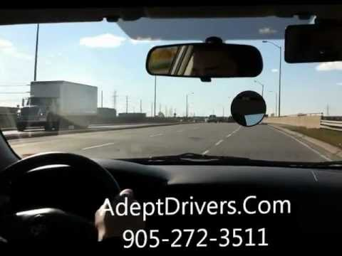 G Licence Road Test Training Sample Lesson Mississauga - Student Driving along with Trucks
