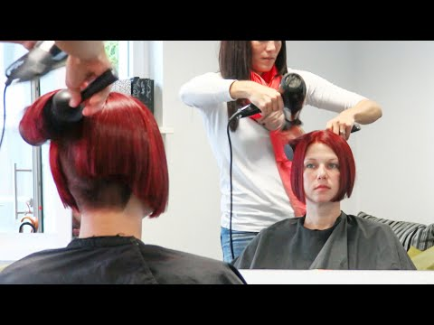 hottest stacked bob haircut with clippered nape and red hair color
