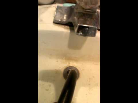 Unclog bathroom sink using a drain bladder