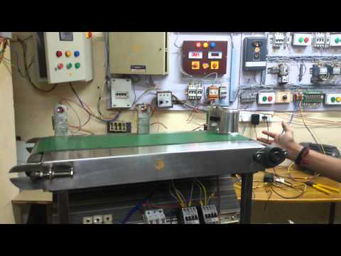 conveyor belts and motors controlled by PLC s  by Dhanaraju sir