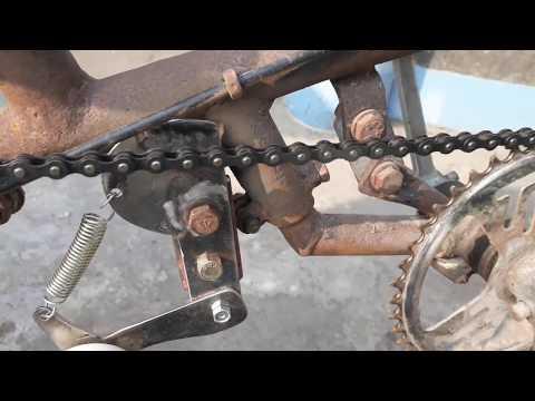 Motor powered bike chain tensioner
