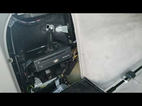 How to Remove Navigation Drive Unit from BMW X3 2008 for Repair.