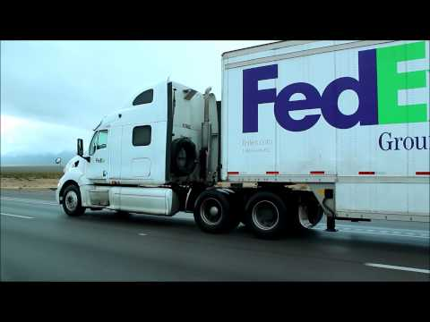 Peterbilt Fed Ex Ground truck pulling doubles on I-15 southbound