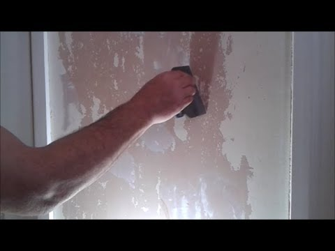 Filling holes before hanging lining paper
