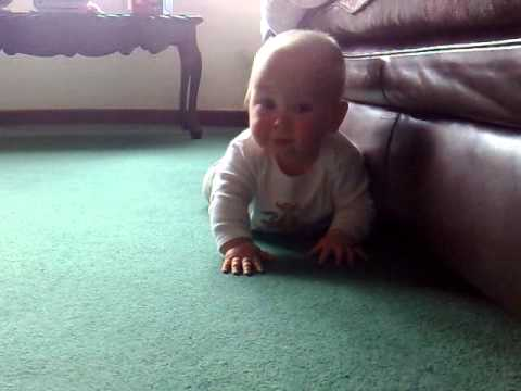 10 month old baby still learning to crawl