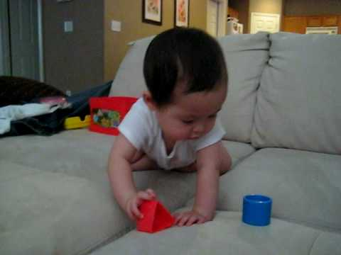 Baby Lara learning to lunge foward into a crawl