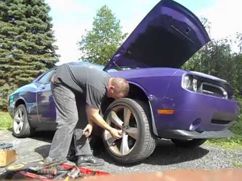 How to install front brakes and rotors on a 2010 Dodge Challenger SRT8 Part 1