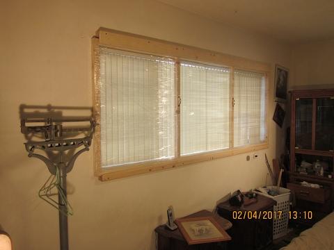 sliding shrinkwrap storm window