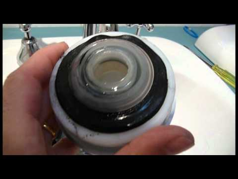 How to repair a leaking Caroma Dual Flush Toilet (by changing the outlet flush valve)