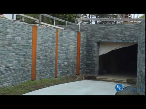 Curved stone walls leading to the underground garage