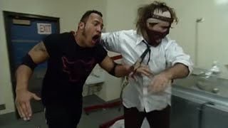 The Rock and Mankind use popcorn for something besides snacking: Halftime Heat, Jan. 31, 1999