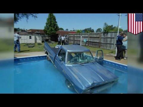 Dog driving car: Cute black lab crashes pickup truck into swimming pool - TomoNews