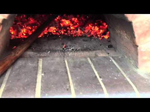Baking bread in a cob oven
