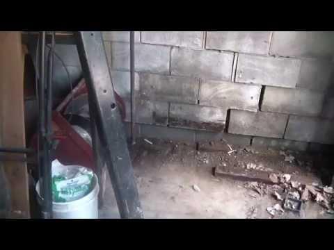 8_1_15, Garage block wall damaged, needs rebuild,