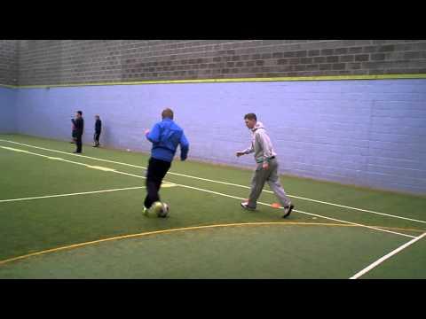 Dribbling and tackling drill - football