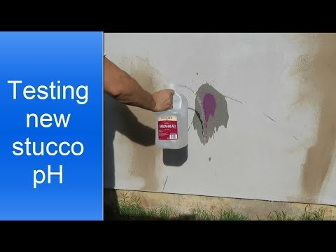 Testing new stucco pH level before painting.