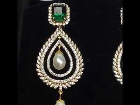 Green stone earring with 3 carat E F VVS quality Diamond