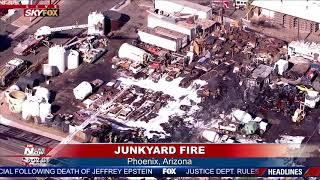 JUNKYARD FIRE: Fire crews battle heat and blaze in Phoenix, AZ
